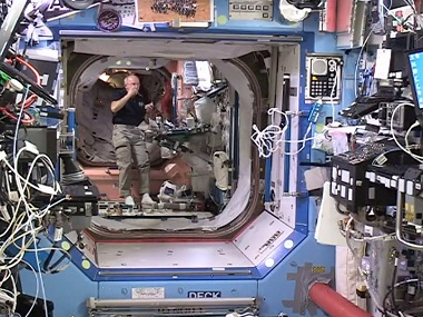 In this image from video provided by NASA, astronaut Jeff Williams floats inside the Bigelow Expandable Activity Module. AP.