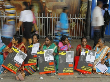 File photo of Sri Lankan Tamil women holding placards with portraits of their missing relatives. AP.