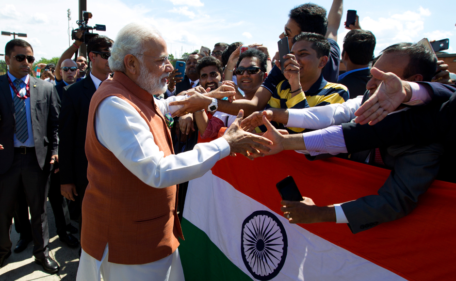 Prime Minister Narendra Modi shake hands with member of the Indian community in Washington upon his arrival at Andrews Air Force Base, Md. PM Modi in a three-day visit to Washington, will meet with President Barack Obama and will address a joint meeting of the US Congress. AP