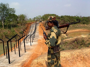An Indian solider stands guard near the Indo-Bangladesh border. Reuters