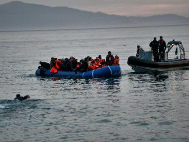 File image of migrants in a boat. AFP