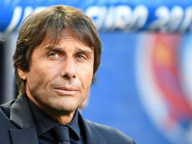 Italy's coach Antonio Conte looks on during the Euro 2016 quarter-final match against Germany. AFP