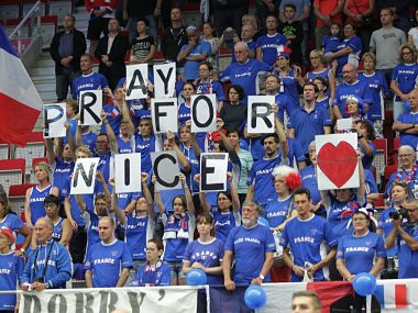 "French fans show ""Pray for Nice"" banners to honor victims. AP"