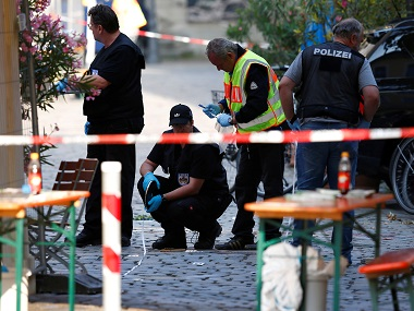 Police secure the area after the explosion in Ansbach. Reuters