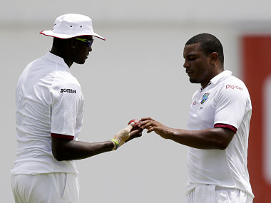 Jason Holder with Shanon Gabriel, the only West Indian bowler who was able to trouble Indian batsmen. AP