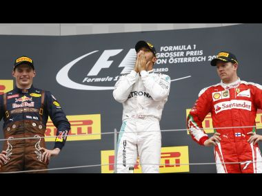 Lewis Hamilton flanked by Max Verstappen and Kimi Raikkonen pose after the race. Reuters