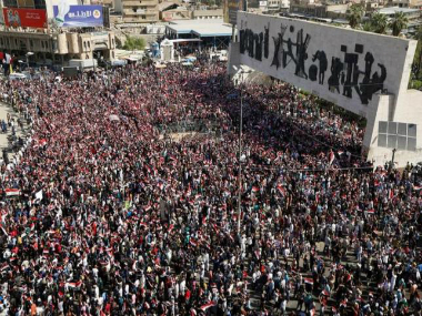 Supporters of Iraqi Shi'ite cleric Moqtada al-Sadr shout slogans during a protest at Tahir Square