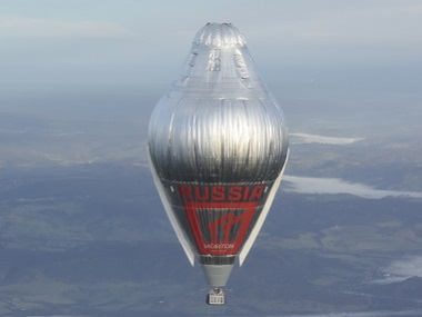 Russian adventurer Fedor Konyukhov floats at more than 6,000 meters (20,000 feet) above an area close to Northam in Western Australia state in his helium and hot-air balloon as he makes a record attempt to fly solo in a balloon around the world nonstop. Morton via AP.