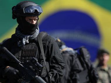 A Brazilian policeman takes part in a military exercise during presentation of the security forces for the Rio 2016 Olympic Games. AP