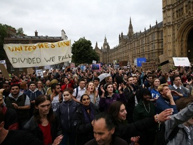 Demonstrators march onto College Green outside The Houses of Parliament at an anti-Brexit protest in London on 28 June. AFP