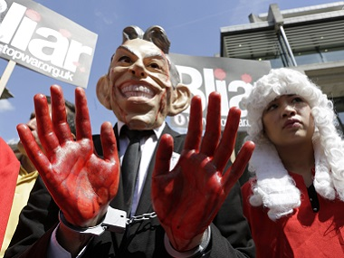 A demonstrator wearing a mask to impersonate Tony Blair protests before the release of the John Chilcot report into the Iraq war, at the Queen Elizabeth II centre in London. Reuters