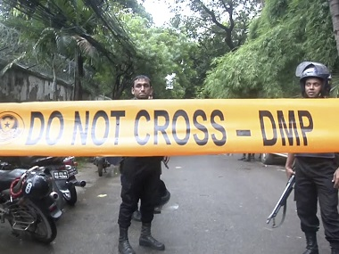 Bangladeshi security forces block the road after militants took hostages at a restaurant. AP