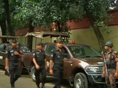 Policemen outside the bakery where the attack took place in Dhaka. Reuters