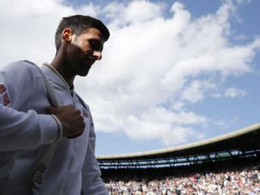 Novak Djokovic leaves the court after losing to Sam Querrey at Wimbledon. AFP