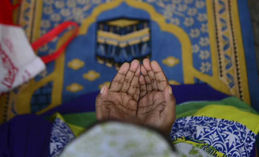 A woman prays at during Eid-ul-fitr in Dhaka on Thursday. AFP