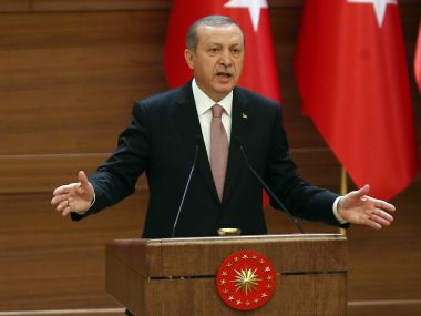 "Turkish President Recep Tayyip Erdogan delivers a speech during a mukhtars meeting at the presidential palace on November 26, 2015 in Ankara. President Recep Tayyip Erdogan on November 26 said Turkey does not buy any oil from Islamic State, insisting that his country's fight against the jihadist group is ""undisputed"". AFP"