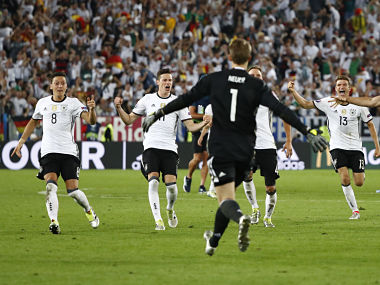Germany players celebrate winning the penalty shootout against Italy. Reuters