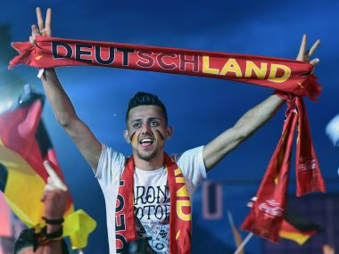 A German supporter holding onto a Deutschland banner. AFP