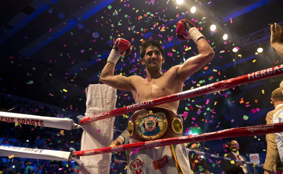 Indian boxer Vijender Singh celebrates after wining WBO Asia Pacific Super Middleweight title against Australia's Kerry Hope in New Delhi, India, Saturday, July 16, 2016. (AP Photo/Tsering Topgyal)