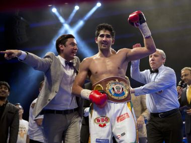 Vijender Singh reacts after wining WBO Asia Pacific Super Middleweight title against Kerry Hope. AP
