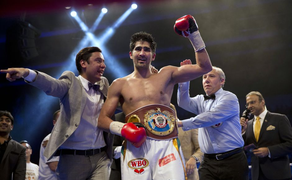 Indian boxer Vijender Singh reacts after wining WBO Asia Pacific Super Middleweight title against Australia's Kerry Hope in New Delhi, India, Saturday, July 16, 2016. (AP Photo/Tsering Topgyal)