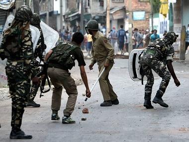 Srinagar: Security jawans chashing away stone throwing youths during a clash in Srinagar on Thursday. PTI Photo by S Irfan (PTI7_14_2016_000262B)