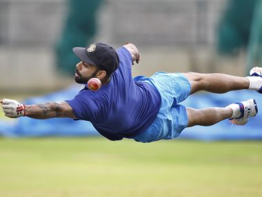 Virat Kohli diving to catch a ball during practice. AP