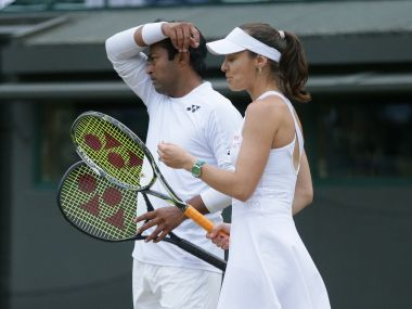 Leander Paes and Martina Hingis failed to defend their mixed doubles crown at Wimbledon. AP