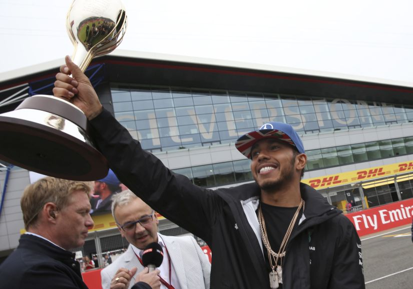 Lewis Hamilton hold the trophy he received as 2015 best British Formula One driver. AP
