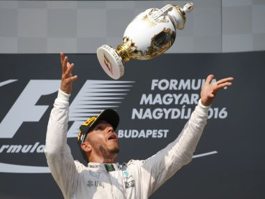 Mercedes' Lewis Hamilton celebrates after winning the race. Reuters