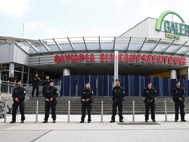 Police stand guard outside the Olympia shopping mall, where Friday's shooting rampage started, in Munich. Reuters
