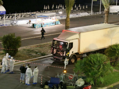 Authorities investigate the truck after it plowed through Bastille Day revelers in Nice, France. AP