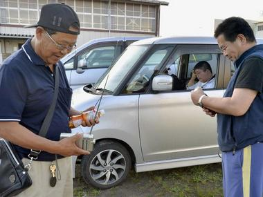 Local residents listen to radio broadcasts to gather information after Tsunami warnings were issued last week. Reuters