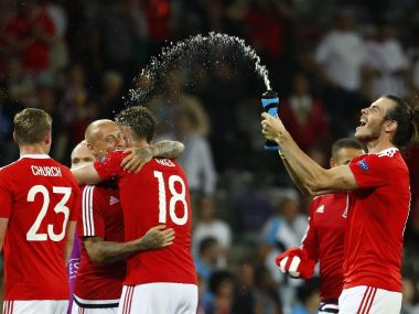 Wales' players celebrate after match against Russia. Reuters