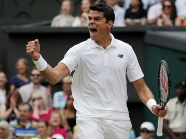 Milos Raonic celebrates winning against Roger Federer in the Wimbledon semi-final. AP