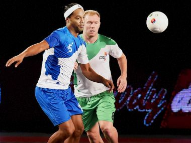 Team captains of Goa5s' Ronaldinho and Bengaluru5s' Paul Scholes in action during Premier Futsal. PTI