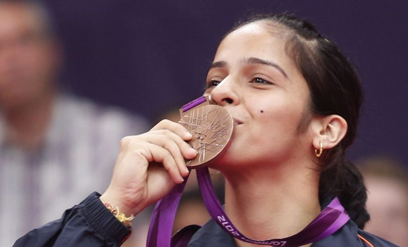 India's Saina Nehwal with her bronze medal at the London Olympics. Reuters