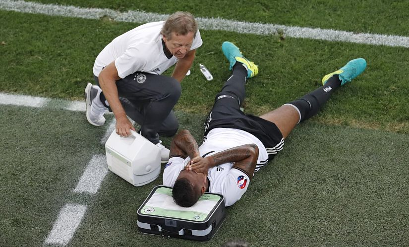 Germany's Jerome Boateng reacts after he was taken off injured against France in the 61st minute. AP