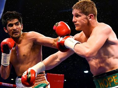 Vijender Singh in action against Kerry Hope. PTI