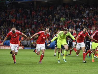 Wales' players celebrate after their Euro 2016 quarter-final win over Belgium. AFP
