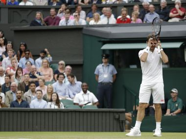 Switzerland's Stan Wawrinka jokes about needing glasses during his match against Del Potro at the Wimbledon. AFP