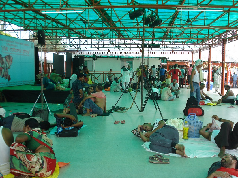With halls packed to capacity, devotees are forces to seek shelter in a shed. Ambika Choudhary Mahajan