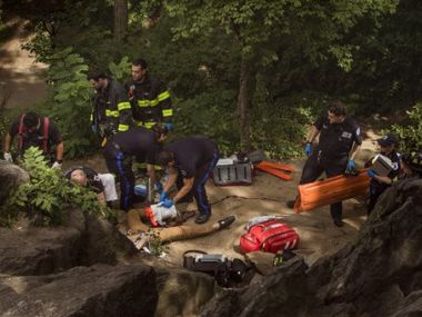 A man gets help from paramedics, firemen, and police in Central Park in New York on Sunday. AP