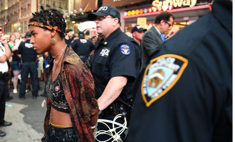 Demonstators are arrested by NYPD after they march through the city and call for justice for Alton Sterling and Philandro Castile in the middle of Times Square on Thursday. Reuters