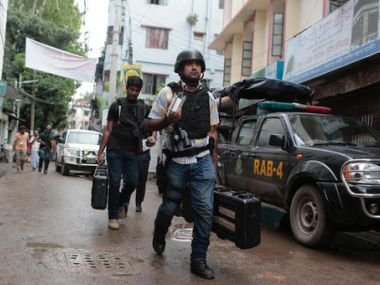 Cops after the raid in Dhaka in Tuesday. AP