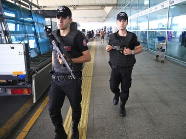 Turkish police officers patrol outside Istanbul's Ataturk airport. AP