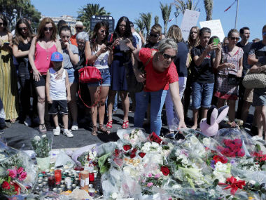 People mourn the Nice attack. AP