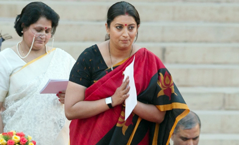 Smriti Irani at a swearing-in ceremony for new cabinet ministers. AP.