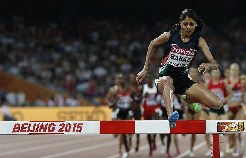 "India's Lalita Shivaji Babar competes in the final of the women's 3000 metres steeplechase athletics event at the 2015 IAAF World Championships at the ""Bird's Nest"" National Stadium in Beijing on August 26, 2015. AFP PHOTO / ADRIAN DENNIS / AFP PHOTO / ADRIAN DENNIS"