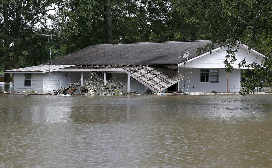 Floods ravaged US state of Louisiana, leaving six people dead. Thousands were forced to flee as water level rose after days of rainfall. Photo: Reuters